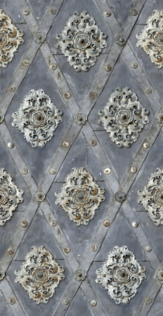 seamless texture door bind with iron nailed metal baroque floral decoration photo