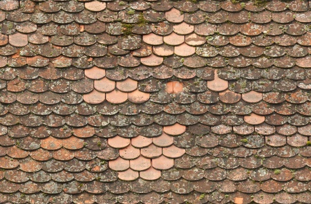 seamless red old roof tiles repaired  texture background photo