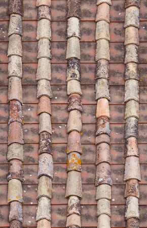 repaired: seamless red old roof tiles repaired  texture background