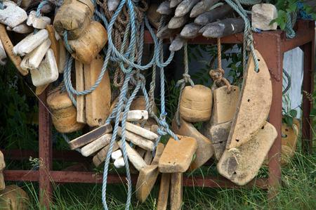 foam plastic float, old fishing nets closeup photo