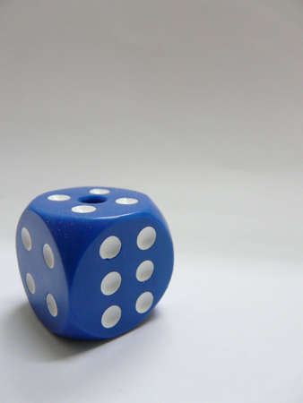 A blue die Stock Photo