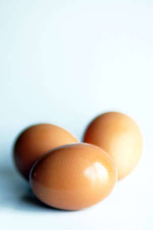 Three eggs on a light blue background