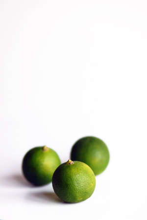 3 Green Limes on a white background Stock Photo