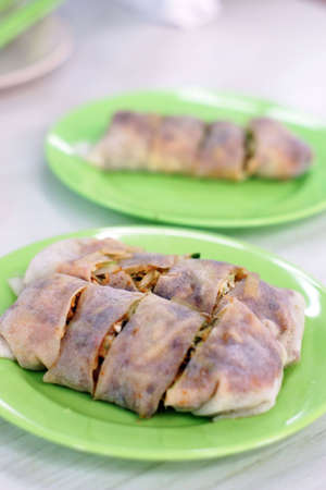 Spring rolls on green plate