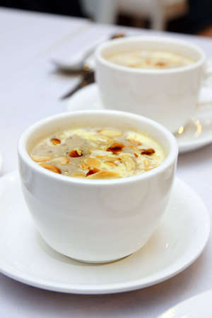 Mushroom soup with Almond in a bowl Stock Photo