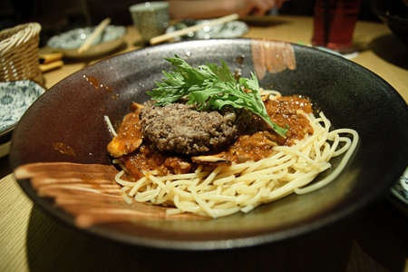 A mouth watering pasta and beef burger Stock Photo
