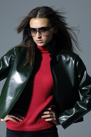 Fashion model in a suit with the sunglasses
