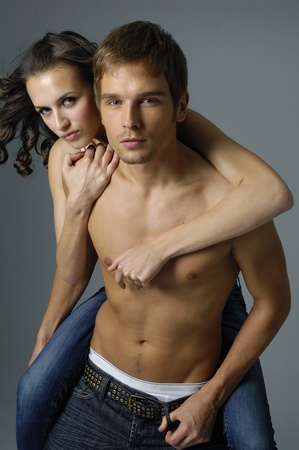 Sexy couple model against white