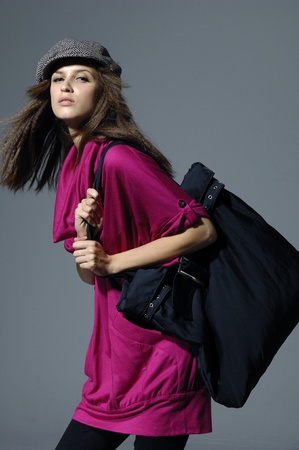 modeling: Beautiful model with a big bag posing