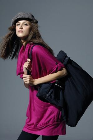 Beautiful model with a big bag posing  photo