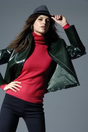 Vogue style photo of fashion model on light background