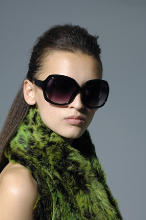 Sunglasses fashion woman on gray photo