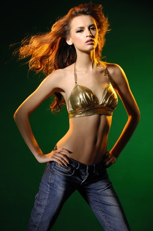 Fashion dancing sexy model on dark  Stock Photo