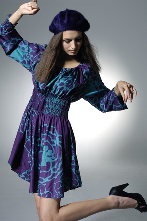 Fashion dancing model on light background