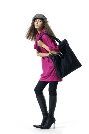 Fashion model with a big bag posing on white