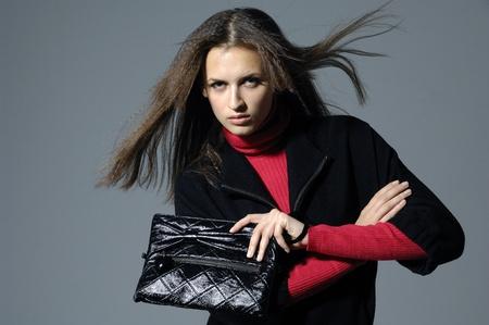fashion model holding little purse