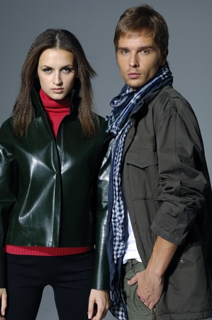 Vogue style photo of young man and woman standing together