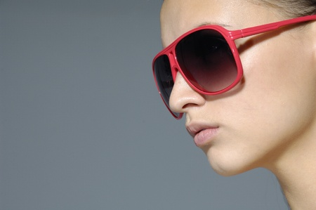 Sunglasses fashion woman on gray Stock Photo - 11232776