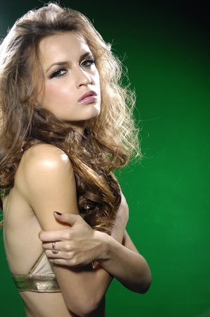 young sexy model on green background