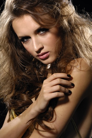 Close up expressive look of fashion model with funning hairs