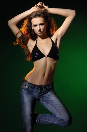 Fashion dancing sexy model on dark green Stock Photo