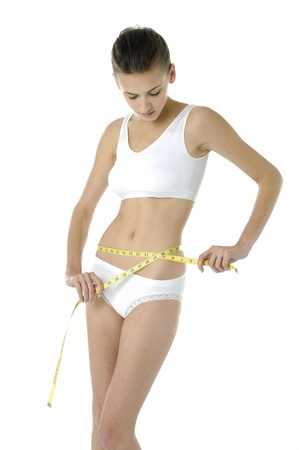 beautiful woman with measure tape on white
