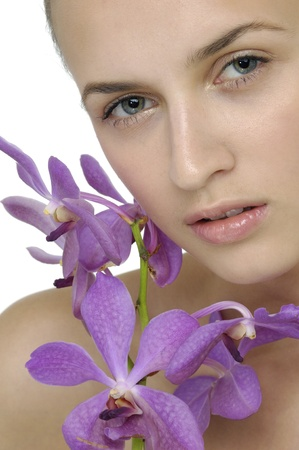portrait of attractive woman with orchid