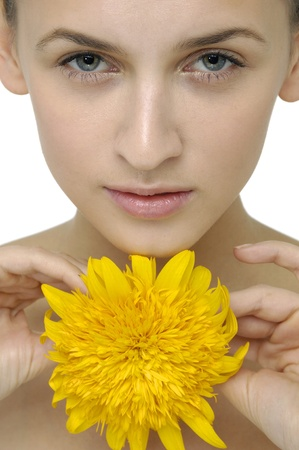 portrait of attractive woman with sunflower photo