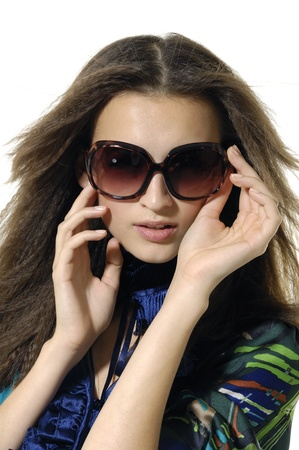 Fashion model wearing the big modern sunglasses. Stock Photo - 11232724