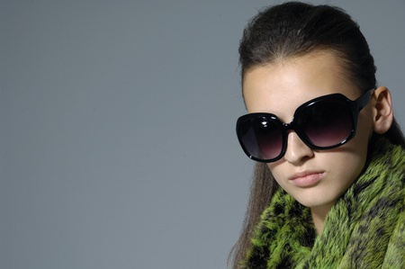 Border of fashion model wearing the big modern sunglasses. photo