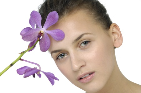 portrait of attractive woman with orchid photo