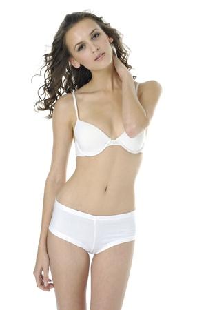 Sexy underwear model on white photo
