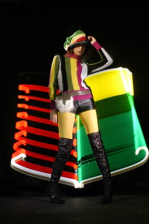 Fashion girl very stylish dancer is posing