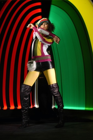 Fashion girl in dance on colorful light background