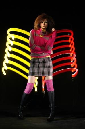 beautiful and very stylish dancer is posing. Photo                                 Stock Photo
