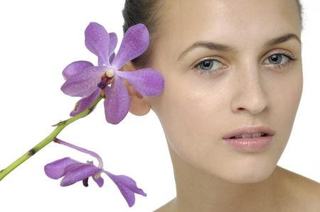 Girl face with orchid flower Stock Photo
