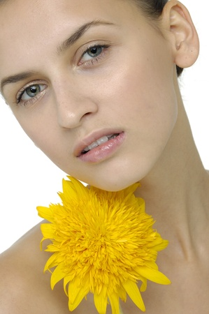 Face of beautiful girl with sunflower photo