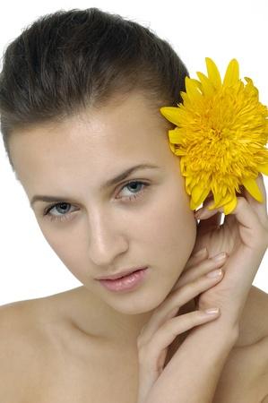 Beautiful girl holding bright flower