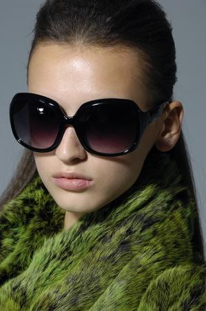 Beautiful girl wearing the big sunglasses.