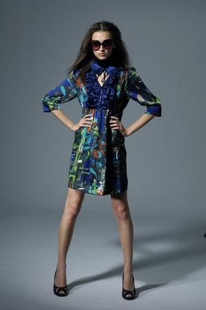Fashion model on gray photo