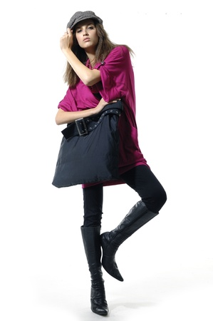 Beautiful girl with a big bag posing  photo