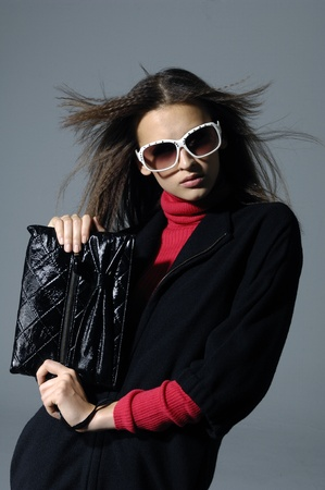 fashion model holding little purse