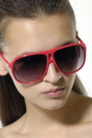 Fashion model wearing the big modern sunglasses. Stock Photo - 12534308