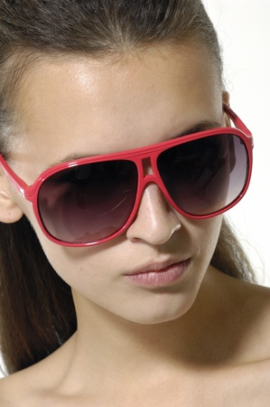 Fashion model wearing the big modern sunglasses. Stock Photo - 12534308