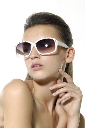Sexy beautiful girl wears sunglasses