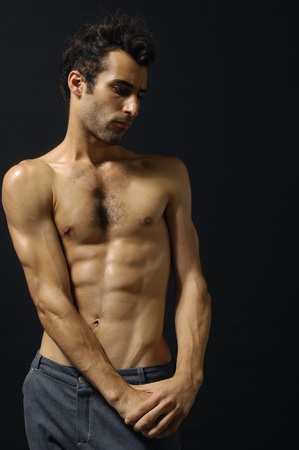 Sport and health body of young man. On black Stock Photo