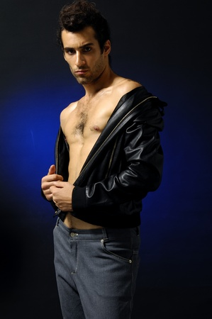 Young fashion man model with athletic body posing