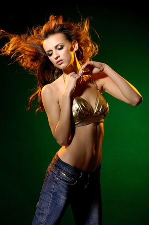 Sexy fashion dancing girl on green  Stock Photo