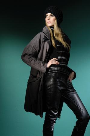 fashion model posing on blue light background