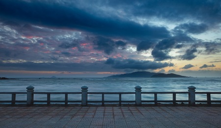 colourful sky: A colourful cloudy morning sky over the south china sea and vinpearl island Vietnam.